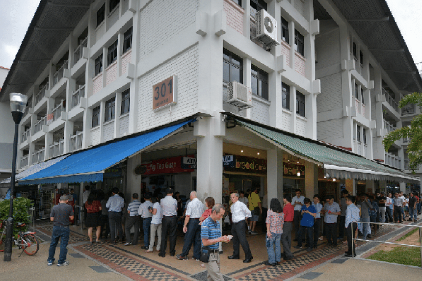 People in a line to buy tickets for the Toto Hongbao Draw at Block 301 Ubi Ave 1 on March 1.