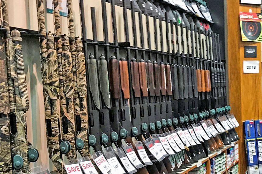 Dick's Sporting Goods said it is immediately ending sales of assault-style rifles in its stores and will require gun buyers to be at least 21.