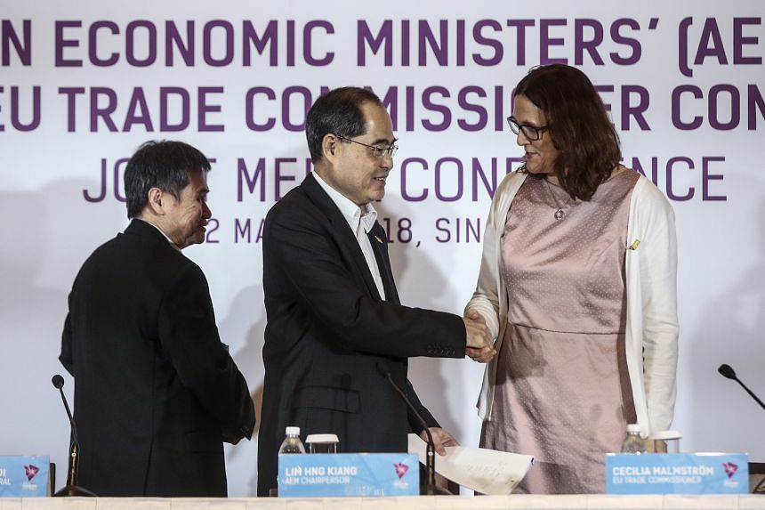 Trade and Industry Minister (Trade) Lim Hng Kiang shakes hands with European Commissioner for Trade Cecilia Malmstrom as Asean secretary-general Lim Jock Hoi) looks on after concluding the 16th Asean Economic Ministers-European Union Trade Commission