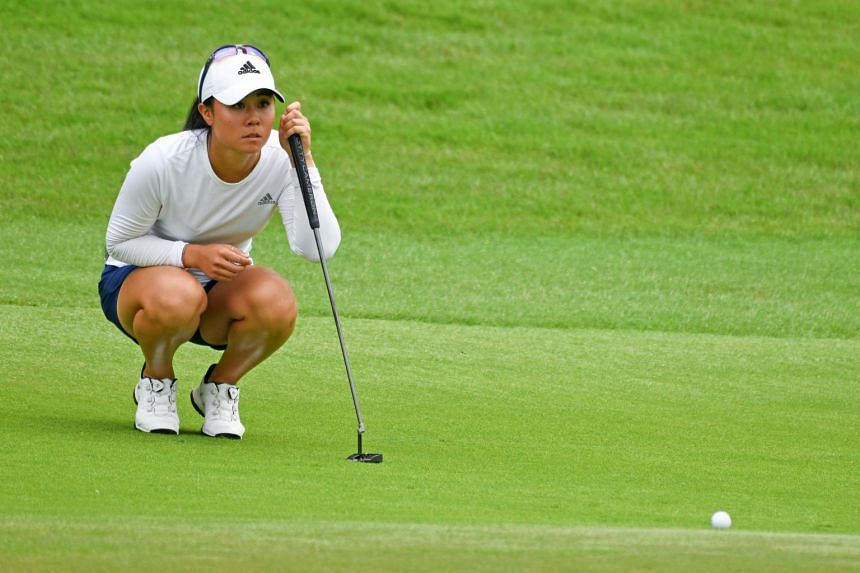 Danielle Kang of the US lines up a putt during round two of the HSBC Women's World Championship golf tournament in Singapore on March 2, 2018.