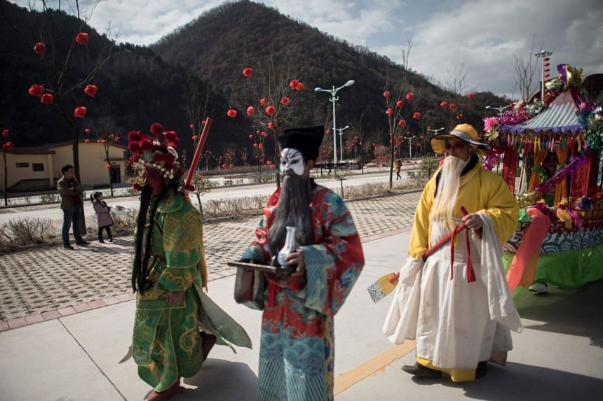 Villagers parade during the She Huo festival in Longxian, China, on Feb 27, 2018.