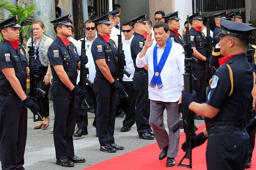 President Rodrigo Duterte salutes while passing members of custom police on Feb 6, 2018.