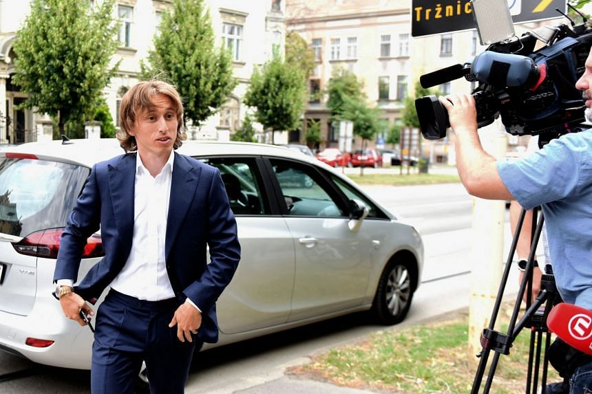 This file photo taken on June 13, 2017, shows Real Madrid midfielder Luka Modric arriving at the Osijek courthouse to testify at the corruption trial of against Dinamo Zagreb's ex-chairman.