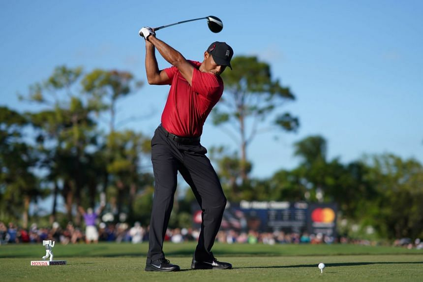Tiger Woods tees off on the 18th during the final round of The Honda Classic golf tournament at PGA National (Champion).