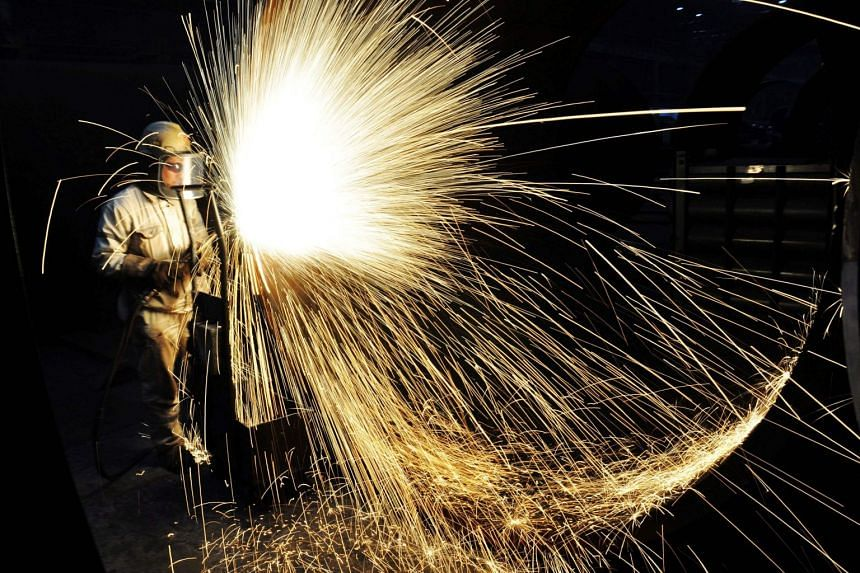 A Chinese worker cutting steel in Qingdao in China's eastern Shandong province on Jan 18, 2018.