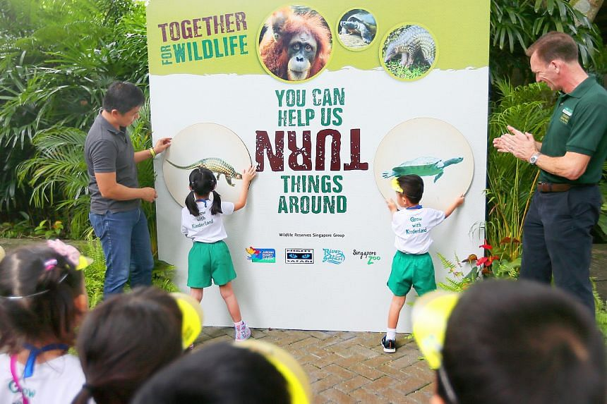 Speaker of Parliament Tan Chuan-Jin (left) and CEO of Mandai Park Holdings Mike Barclay (right) launch the Together For Wildlife campaign at the Singapore Zoo on March 2, 2018.
