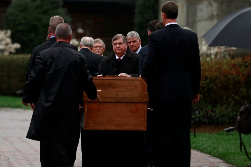 The casket containing late US evangelist Billy Graham is received by his family and others in North Carolina.
