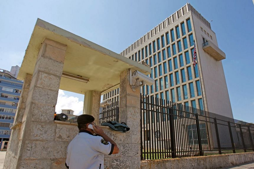 A security guard using a phone outside the US embassy in Havana.
