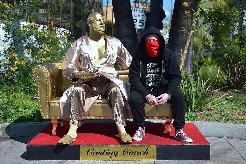"""Casting Couch, a statue of Harvey Weinstein on a couch and holding an Oscar, is the work of artists Plastic Jesus (in photo) and Joshua """"Ginger"""" Monroe."""
