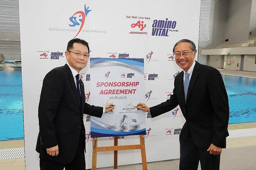 Keita Ishii (left), managing director of Ajinomoto Singapore, with Lee Kok Choy, president of the Singapore Swimming Association. The three-year deal includes cash and in-kind products worth $350,000.