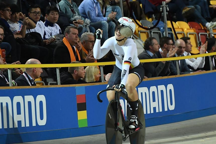 Germany's Kristina Vogel celebrates after victory in the women's team sprint final.