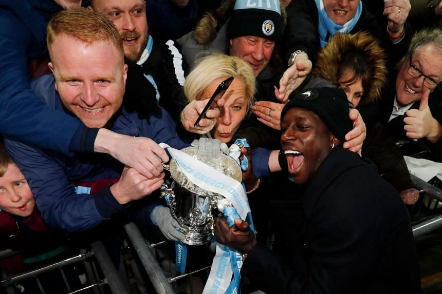 Mendy with Manchester City fans after the team won the League Cup.