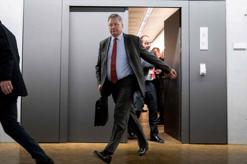 President of the German Federal Intelligence Agency Bruno Kahl leaves after a meeting on the hack.