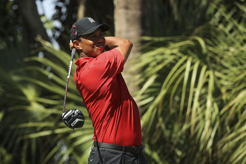 Woods plays his tee shot on the third hole during the final round of the Honda Classic.