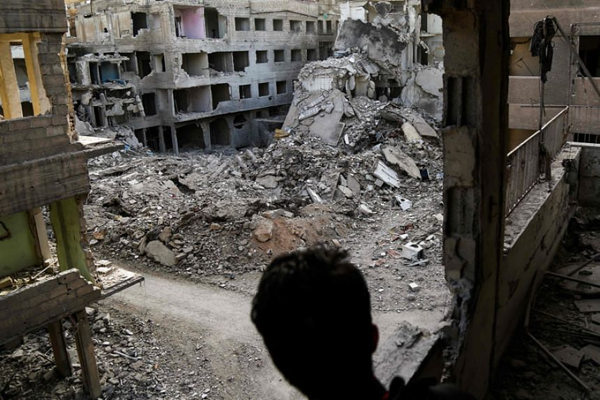 A building severely damaged by shelling is seen in the rebel-held besieged town of Ayn Tarma in the eastern Ghouta region on the outskirts of Damascus on March 2, 2018.