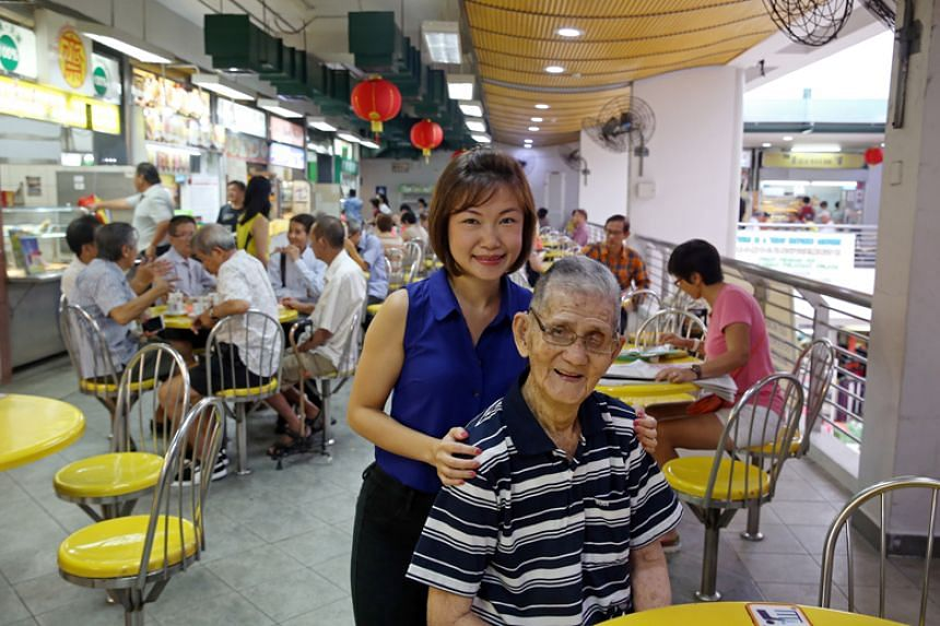 Ms Sandra Leong, one of the three winners of a contest to come up with ideas to reimagine how the elderly can live and play in their communities, with her grandfather Mr Chua Pee Tong.