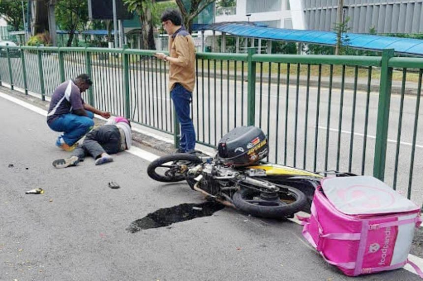 A man lying on the road near a toppled motorcycle following the accident in Balestier on March 1, 2018.