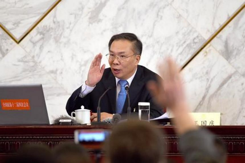 Wang Guoqing, spokesman for the fourth session of the 12th Chinese People's Political Consultative Conference (CPPCC), prepares to answer questions during a press conference on March 2, 2015.