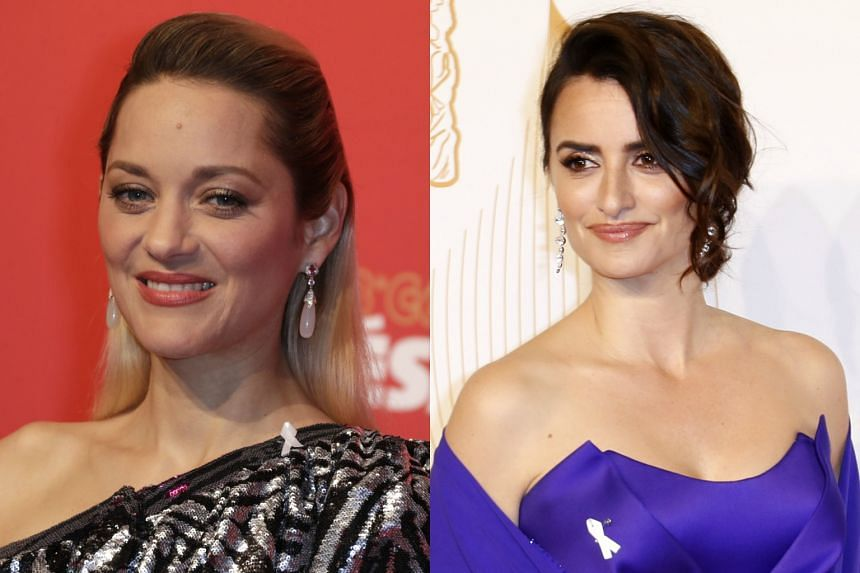 Actresses Marion Cotillard (left) and Penelope Cruz sporting white ribbons to condemn abuse and exploitation at the 'French Oscars' in Paris.
