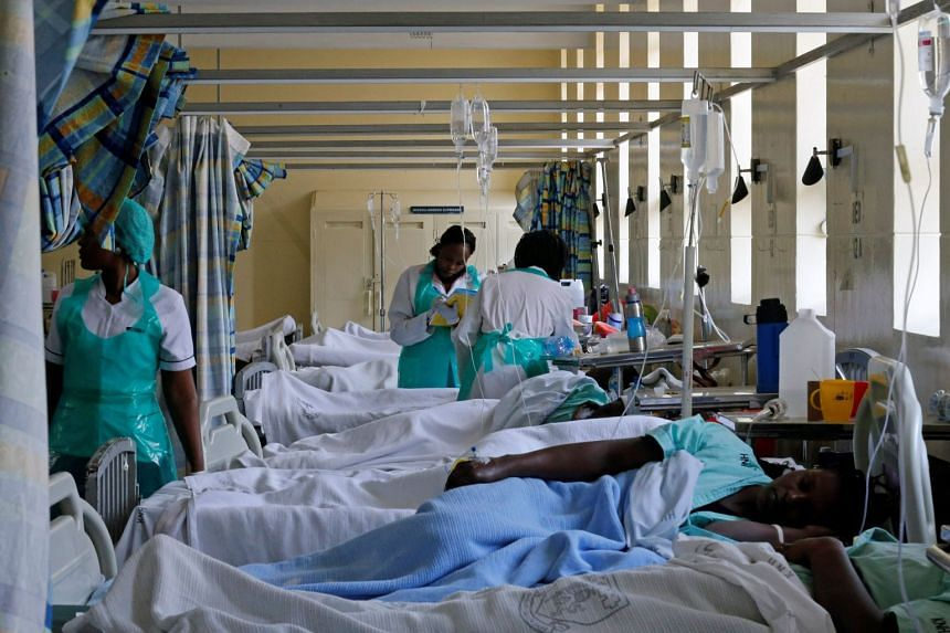 File photo showing medical practitioners attending to a cholera patient inside a special ward at the Kenyatta National Hospital in Nairobi, Kenya, on July 19, 2017.