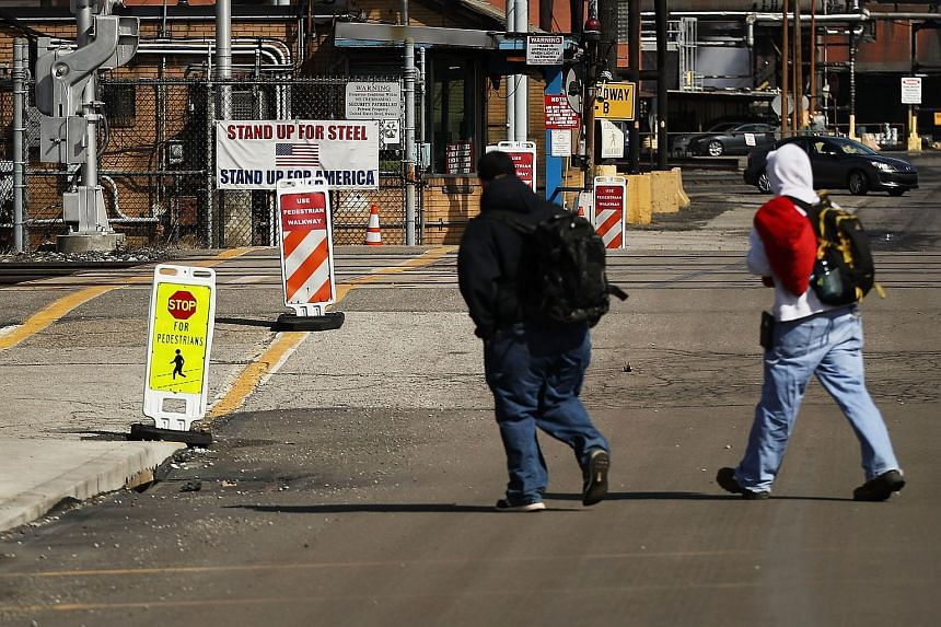Men walk into the United States Steel Corporation plant in the town of Clairton on March 2, 2018.