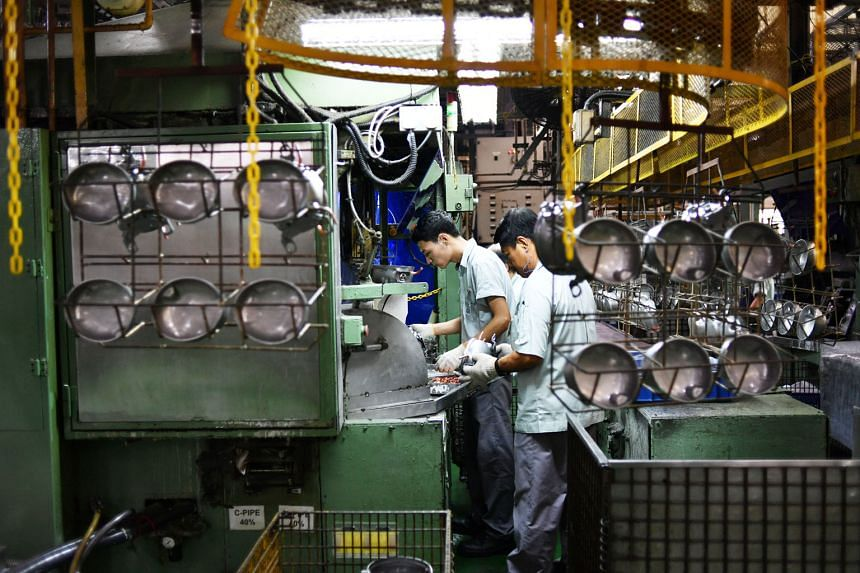 Workers at a refrigerator compressor factory. Last month's lower electronics reading came on the back of slower growth in both factory output and new orders.