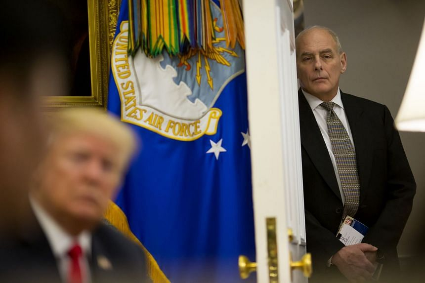 Kelly looks on as Donald Trump meets North Korean defectors at the White House,