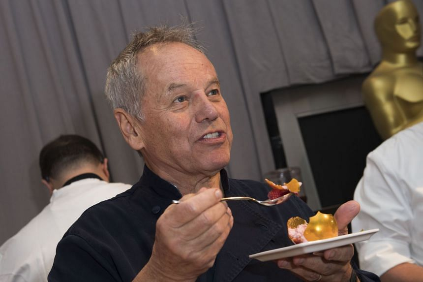 Celebrity chef Wolfgang Puck tastes a confection during a preview for the Governors Ball.
