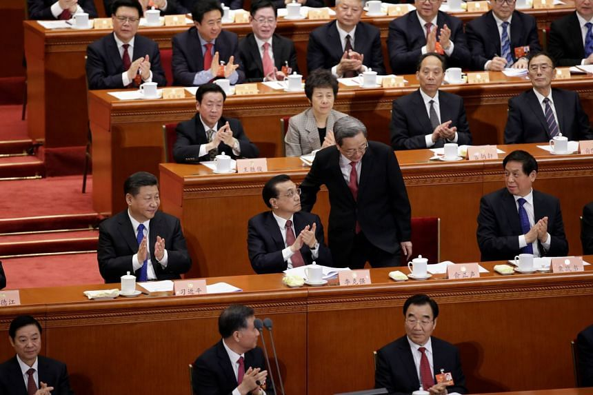 Yu Zhengsheng, chairman of the Chinese People's Political Consultative Conference (CPPCC), returns to his seat after his speech at the opening session of the Chinese People's Political Consultative Conference (CPPCC) at the Great Hall of the People i