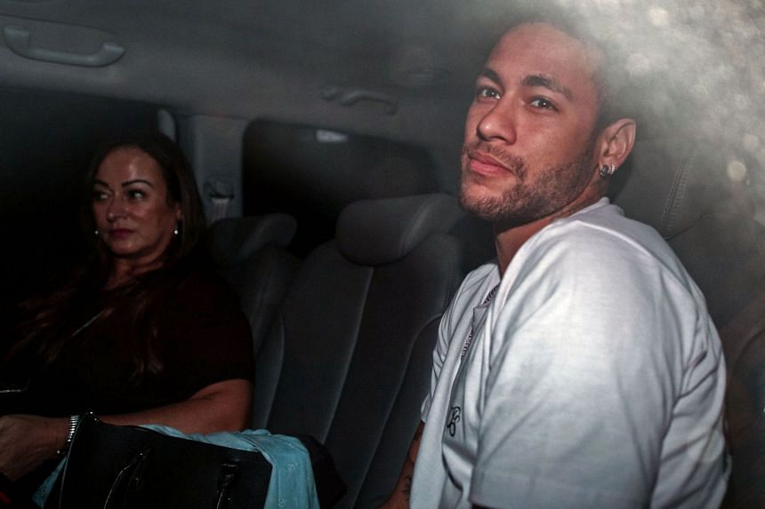 Neymar and his mother Nadine Goncalves Da Silva arrive in Belo Horizonte, Brazil, ahead of an operation on his fractured foot on March 2, 2018.