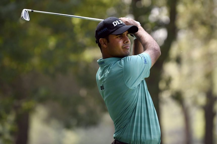Indian golfer Shubhankar Sharma plays his shot from the eighth tee, during the second round of the World Golf Championship in Mexico City on March 2, 2018.