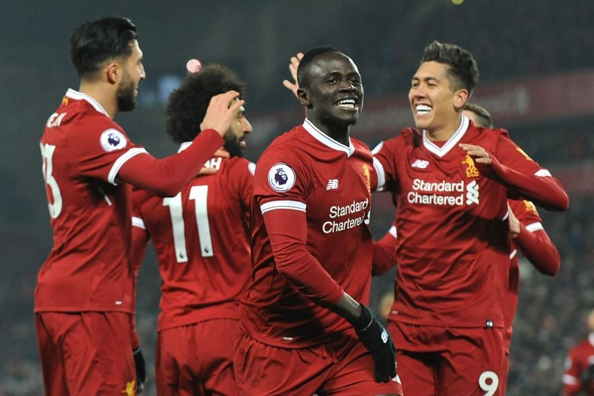 Liverpool's Sadio Mane (centre) celebrates after scoring his sides' second goal.