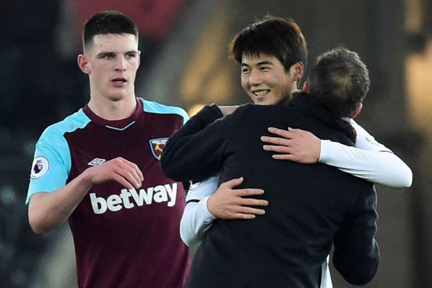 Swansea City manager Carlos Carvalhal celebrates with Ki Sung Yueng after the match.