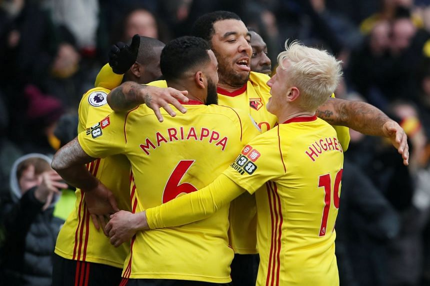 Watford's Troy Deeney celebrates his late goal with team mates.