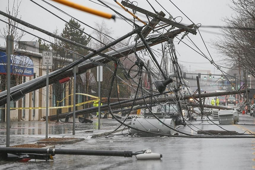 Strong winds leave a tangled mess of felled power poles on Arsenal Street in Watertown, Massachusetts, on Friday.