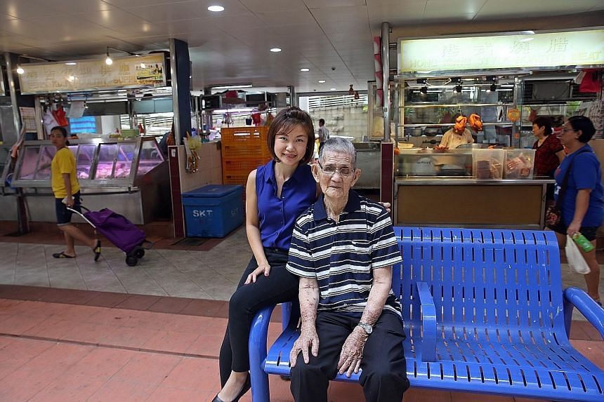 Ms Sandra Leong with her grandfather, Mr Chua Pee Tong. He enjoys going to the market but can do so only if he is accompanied, lest he falls. Ms Leong's idea was to have stalls form the inner core of hawker centres and wet markets and have an outer r