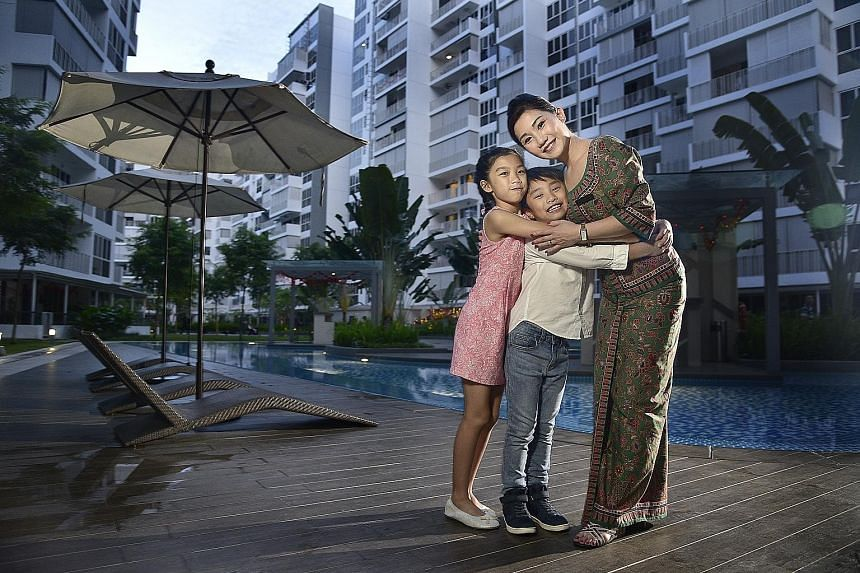 Ms Christina Chia with her daughter Charlize, 11, and son Paxton, eight. Technology such as mobile phones and video chats help her stay in touch with her children when she is away. Being a stewardess also means she does not bring work home, so she is