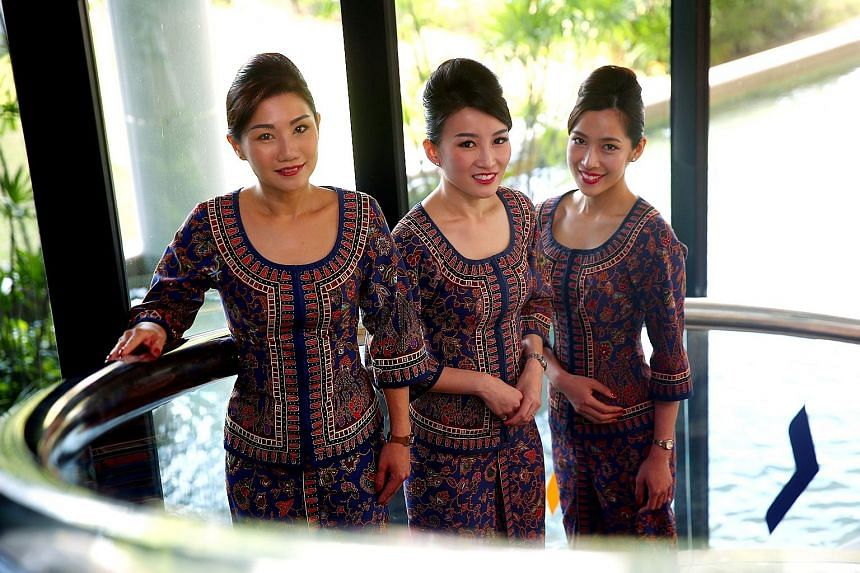Former cabin crew members who have returned to work with Singapore Airlines include (from left) leading stewardess Christina Chia, 38, and flight stewardesses Anna Ye, 33, and Catherine Yap, 30.