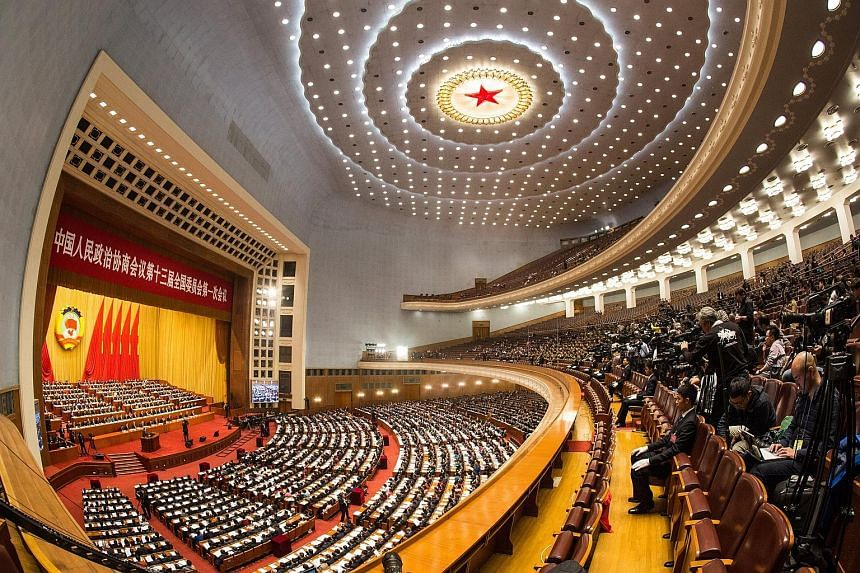 The start of the first session of the 13th Chinese People's Political Consultative Conference at the Great Hall of the People in Beijing yesterday. Delegates will discuss constitutional changes as well as socio-economic issues centred on improving th