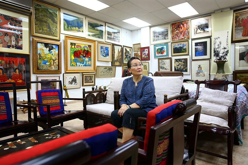 Madam Hedy Mok, the niece of widow Chung Khin Chun, in the art gallery in the annex block of the Gerald Crescent property. Madam Chung's property at 2F, Gerald Crescent, sits on land about the size of half a football field, and has a 999-year lease t