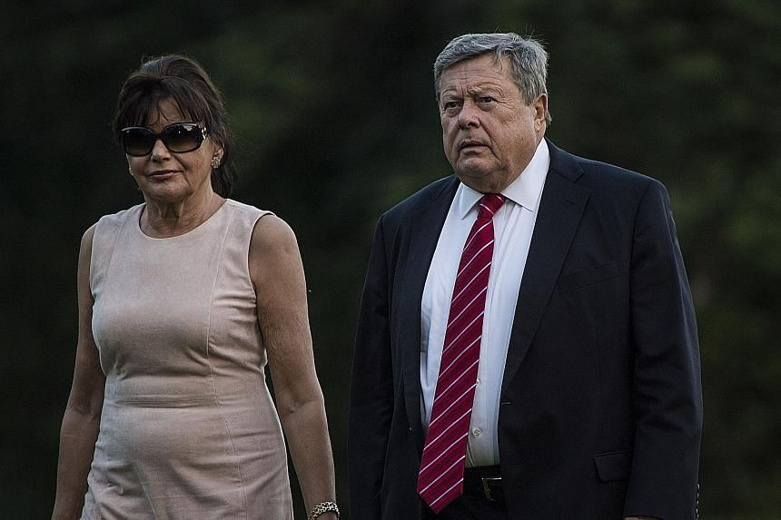 """Mrs Trump's green card under the elite EB-1 programme paved the way for her to sponsor the US residency of her parents (below) Amalija and Viktor Knavs. The visa, known as the Einstein visa, is designed for people of """"extraordinary ability"""". It is th"""