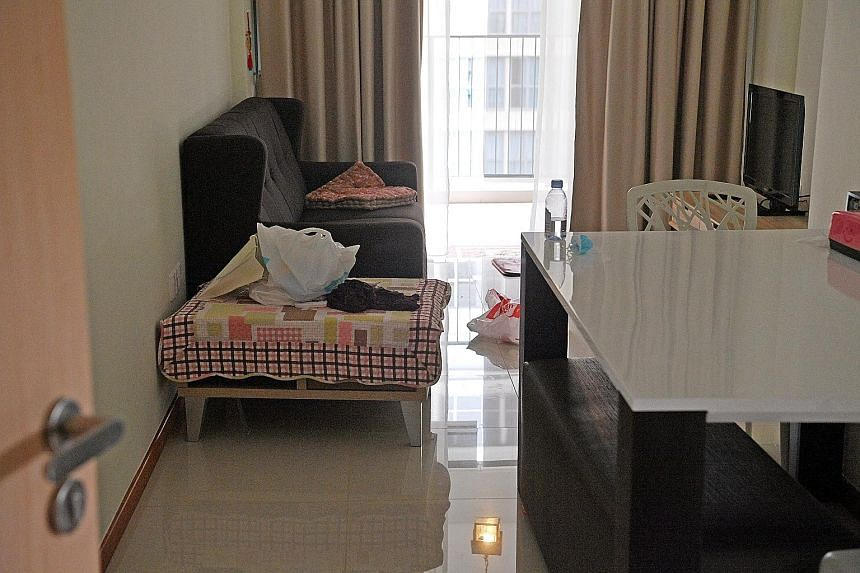 The Tampines flat of Ms Tan Bee Leng (above) that she had been ready to move into before her death in May last year. Her parents continue to visit the apartment regularly to clean it.