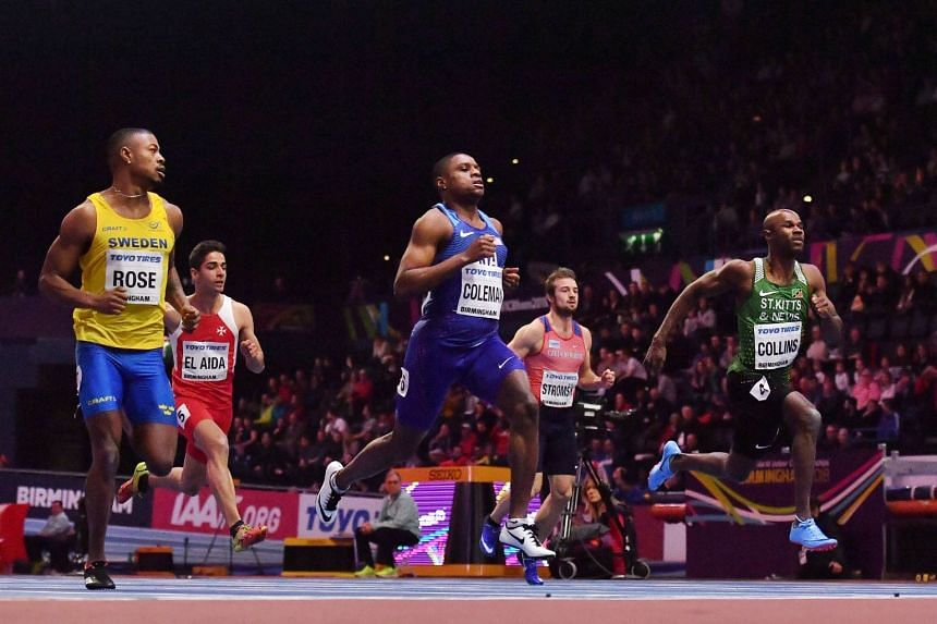Collins (far right) competing in the men's 60m round one event.