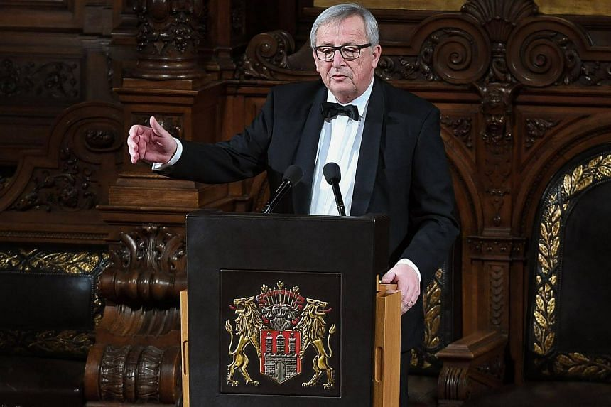 European Commission President Jean-Claude Juncker delivers a speech during the Matthiae-Mahlzeit feast in the town hall of Hamburg, on March 2, 2018.