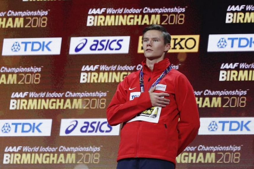 Gold medallist Czech Republic's Pavel Maslak poses on the podium after the men's 400m final at the 2018 IAAF World Indoor Athletics Championships at the Arena in Birmingham on March 3, 2018.
