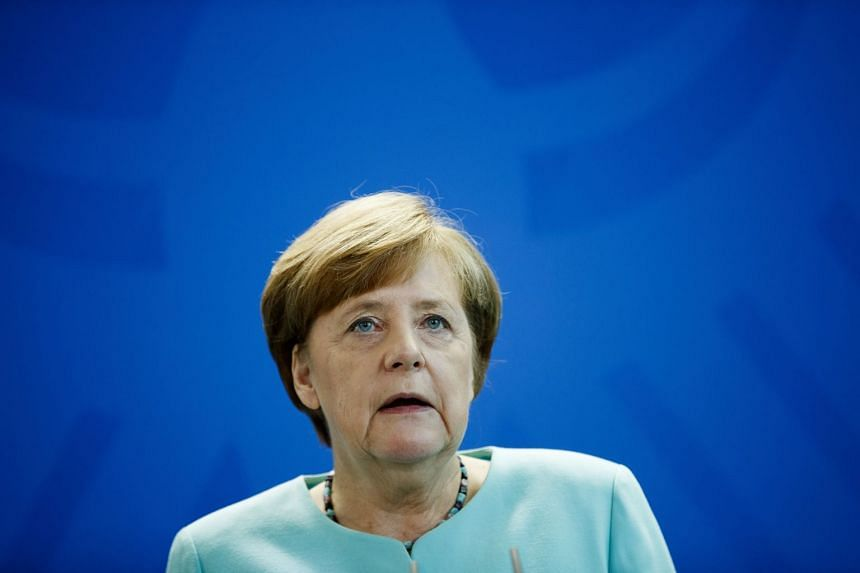 Members of Germany's SPD voted in favour of entering a coalition with Chancellor Angela Merkel (pictured), on March 4, 2018.