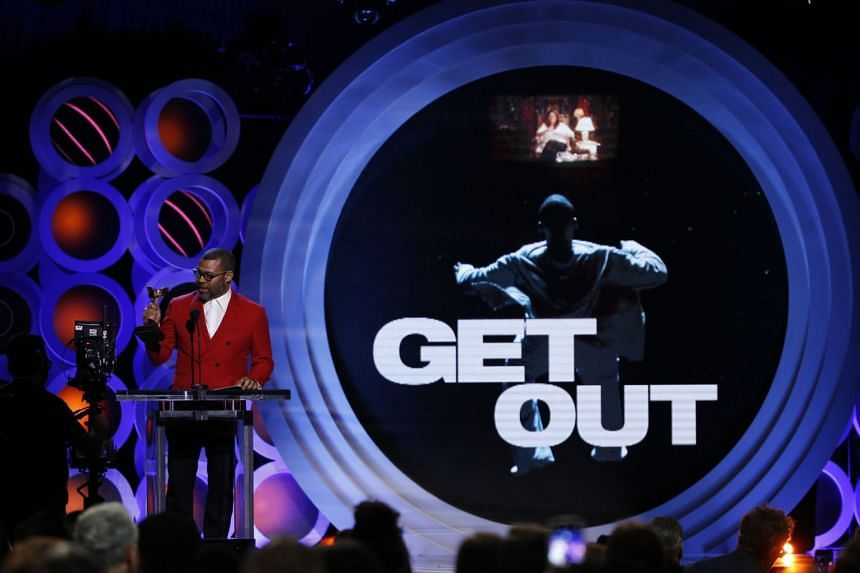 Jordan Peele accepting the Best Director Award for Get Out at the Spirit Awards on March 3, 2018.