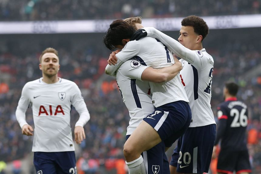 Son celebrates with team mates after scoring Tottenham's second goal.