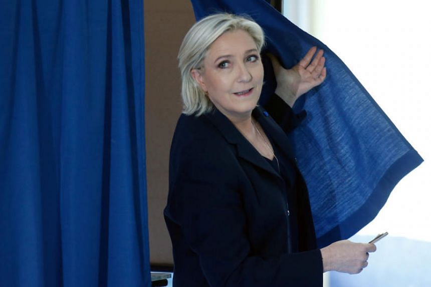 Marine Le Pen  leaves a polling booth as she votes in the first round of 2017 French presidential election at a polling station in Henin-Beaumont, northern France, on April 23, 2017.