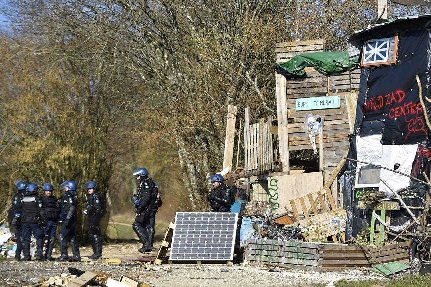 French gendarmes are sent in to help clear the site on Feb 22, 2018.